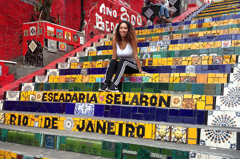 Adelphi student posing on steps in Rio de Janeiro Brazil